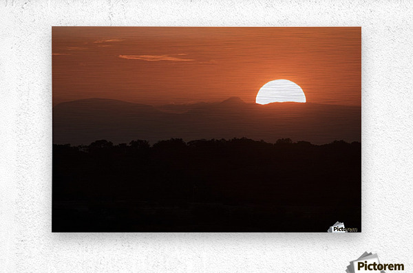 Setting sun overtop of the African landscape; South Africa  Metal print