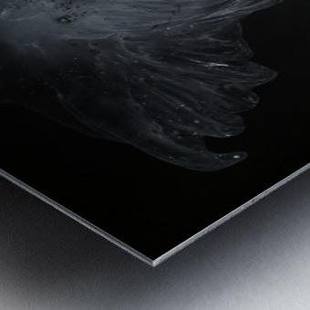 Glowing grey jellyfish in the dark water Metal print