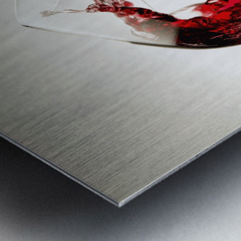 Red wine pouring into a glass Metal print