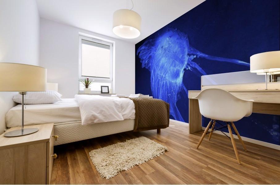 Glowing blue jellyfish in the dark water Mural print