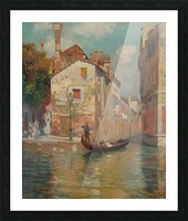 Gondola traveling along a canal in Venice Picture Frame print