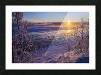 Ice flows in the Tanana River at sunset during freeze up in early winter; Alaska, United States of America Picture Frame print