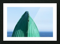 Close-up of  the bottom of the bow of a wooden boat painted green and the tranquil water and blue sky in the background; South Shields, Tyne and Wear, England Picture Frame print