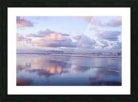 Clouds reflect on an Oregon beach at sunrise; Hammond, Oregon, United States of America Picture Frame print
