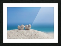 Two white heart shaped coral rocks placed together on sand at the beach; Honolulu, Oahu, Hawaii, United States of America Picture Frame print