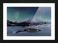 Aurora Borealis (Northern Lights) dance above Idaho Peak and the Little Susitna River at Hatcher Pass in winter, South-central Alaska; Alaska, United States of America Picture Frame print