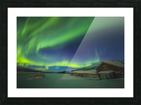 The aurora fills the sky above the historic Black Rapids Roadhouse along the Richardson Highway on a bitterly cold night; Alaska, United States of America Picture Frame print