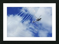 An HH-60H Sea Hawk helicopter releases countermeasure flares. Picture Frame print