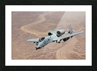 An A-10 Thunderbolt soars above the skies of Iraq. Picture Frame print