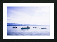 Sunrise in the Osa peninsula with boats in harbour Picture Frame print