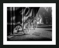 Bicycle parked against the building black and white Picture Frame print