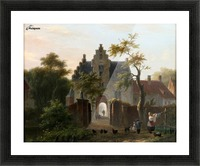 A woman hanging the wash in front of the gates Picture Frame print
