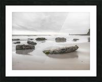 Rocks on a sandy beach Picture Frame print