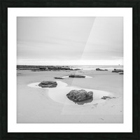 Rock pools on a sandy beach Picture Frame print