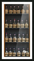 Old wine bottles on wooden shelf Picture Frame print