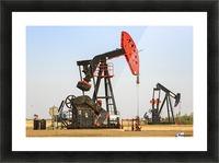 Oil well pump jacks at Bakken Oil Field near Estevan; Saskatchewan, Canada Picture Frame print