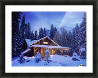 Cabin in the woods illuminated by Christmas lights Picture Frame print