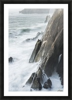 Surf breaks on the rocks; Manzanita, Oregon, United States of America Picture Frame print