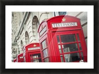 Telephone boxes in a row; Blackpool, Lancashire, England Picture Frame print