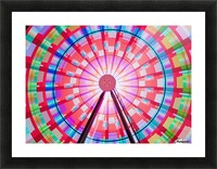 Long exposure photograph showcasing the many color combinations the Big Wheel produces at night; Seattle, Washington, United States of America Picture Frame print