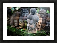 Heads of statues of Buddha are stacked in a terra-cotta factory; Chiang Mai, Thailand Picture Frame print
