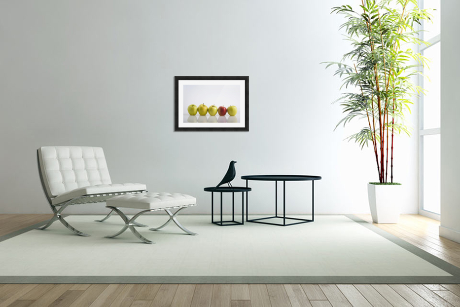 Four Yellow Apples With One Red Apple In A Row On A Reflective Surface; Calgary, Alberta, Canada in Custom Picture Frame