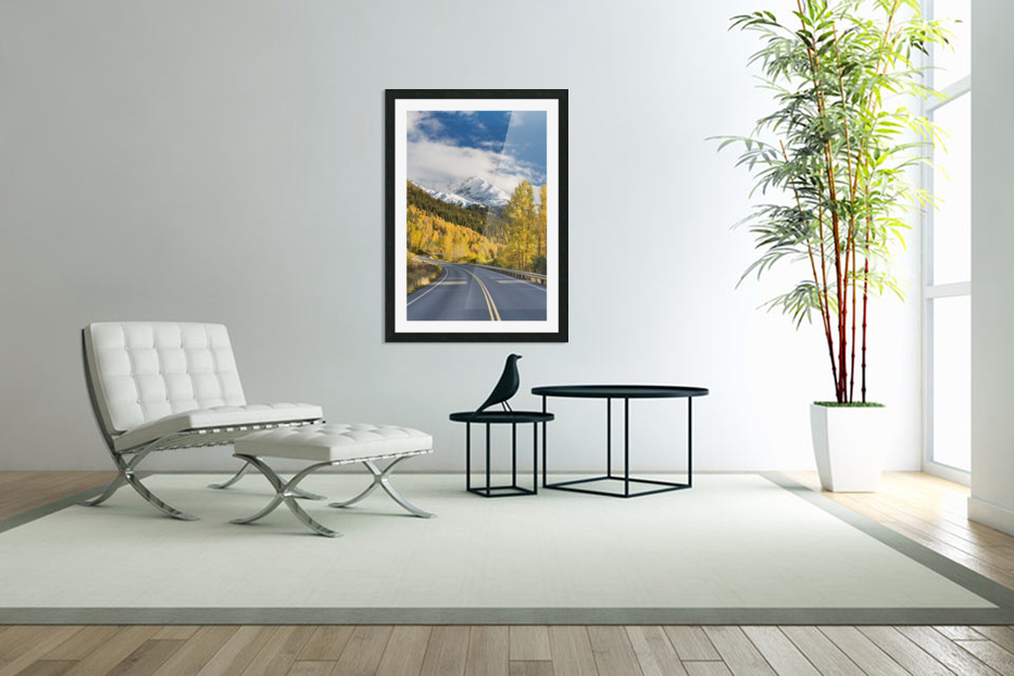 Snow-capped Kenai Mountains dwarf the Seward highway, trees covered in yellow leaves in autumn line the road, South-central Alaska; Seward, Alaska, United States of America in Custom Picture Frame
