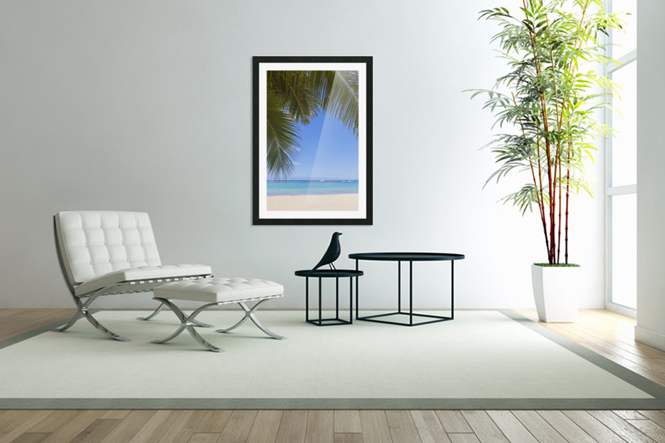 Beautiful clear day on a white sandy beach with coconut palm tree fronds hanging above; Honolulu, Oahu, Hawaii, United States of America in Custom Picture Frame
