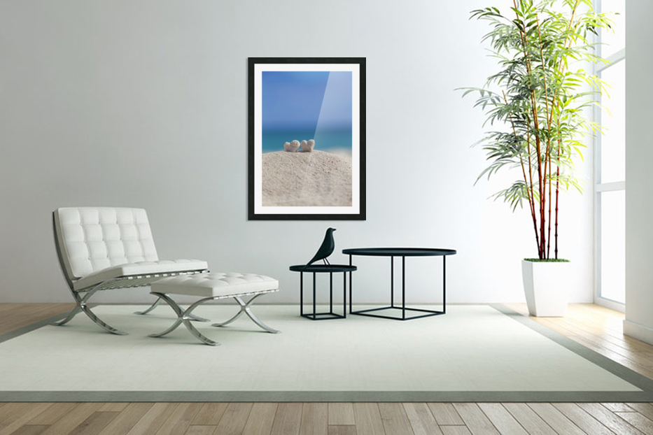 Two white heart shaped coral rocks placed together on sand at the beach; Honolulu, Oahu, Hawaii, United States of America in Custom Picture Frame