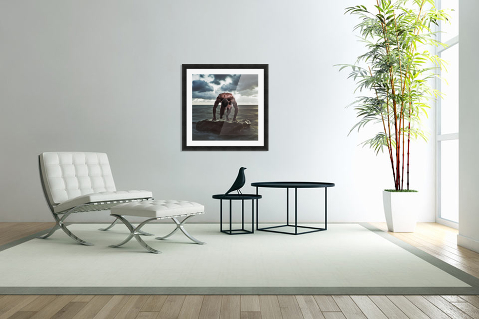 A muscular man in the starting position on a wet rock in the water;Tarifa cadiz andalusia spain in Custom Picture Frame