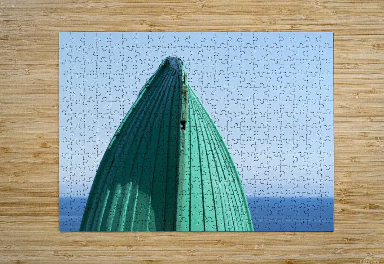 Close-up of  the bottom of the bow of a wooden boat painted green and the tranquil water and blue sky in the background; South Shields, Tyne and Wear, England  HD Metal print with Floating Frame on Back