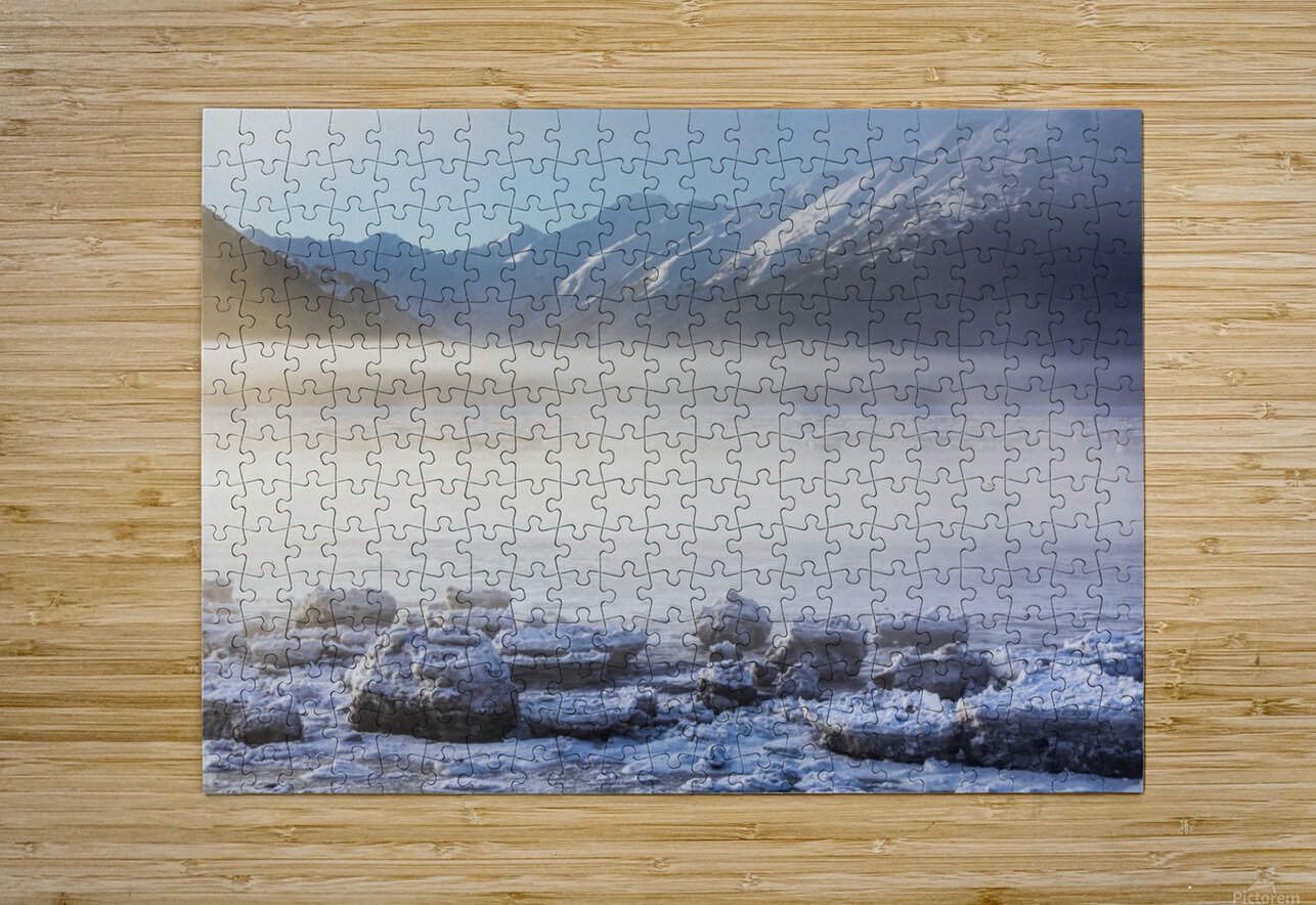 The sun shines through low altitude fog cast in warm light along Turnagain Arm and the Seward Highway, sea ice covering the ocean in the foreground, the Kenai Moutains revealed in the background, South-central Alaska; Alaska, United States of America  HD Metal print with Floating Frame on Back
