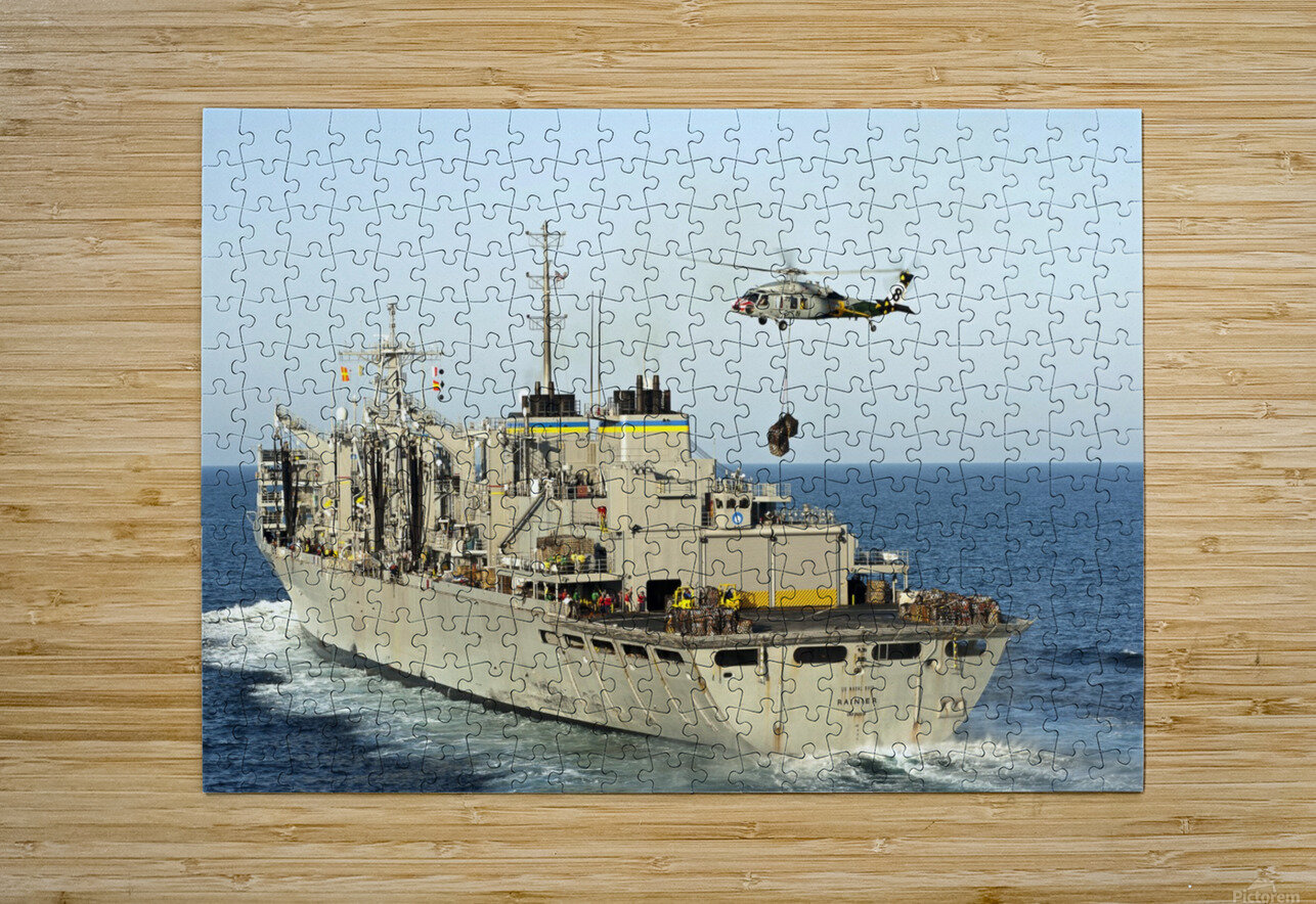 An MH-60S Knighthawk lifts cargo from the fast combat support ship USNS Rainier.  HD Metal print with Floating Frame on Back
