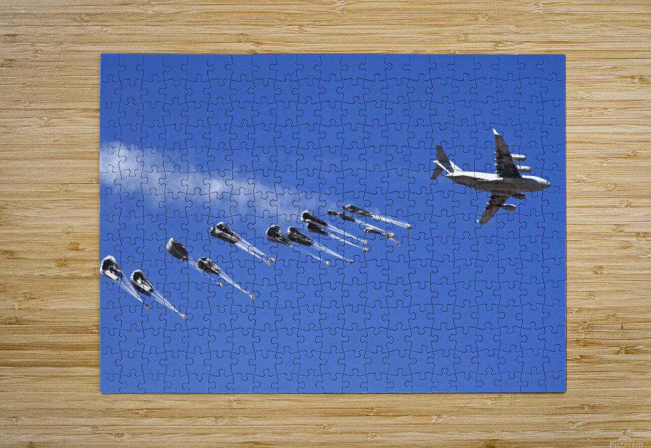 A C-17 Globemaster ejects a supply load of pallets during Operation Koranai Permakhtag.  HD Metal print with Floating Frame on Back