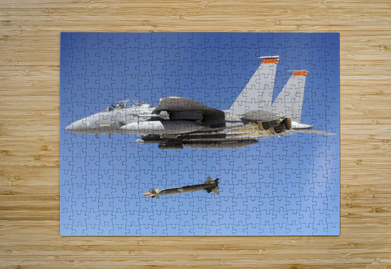 An F-15E Strike Eagle drops a GBU-28 bomb during a Combat Hammer mission.  HD Metal print with Floating Frame on Back