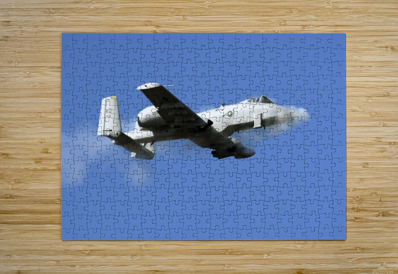 An A-10 Thunderbolt II pilot fires the planes 30-mm cannon.  HD Metal print with Floating Frame on Back