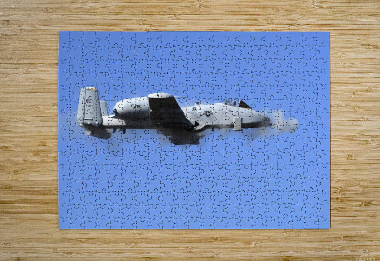 A pilot in an A-10 Thunderbolt II fires the planes 30-mm cannon.  HD Metal print with Floating Frame on Back