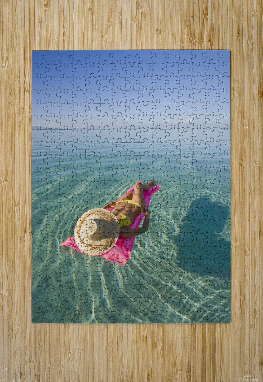 French Polynesia, Tahiti, Moorea, Woman Floating In Water.  HD Metal print with Floating Frame on Back