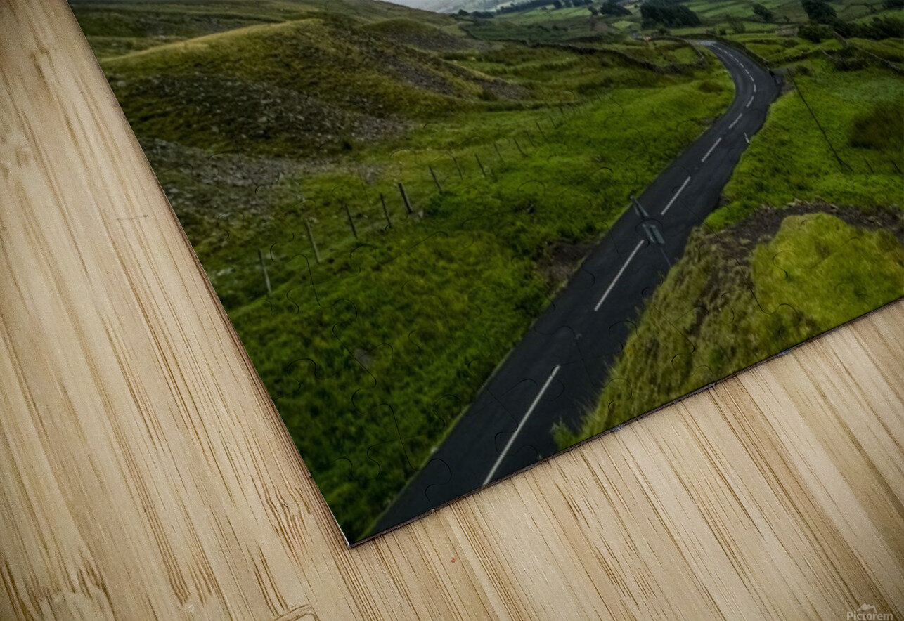 Dark storm clouds over a lush, green landscape and road; North Yorkshire, England HD Sublimation Metal print