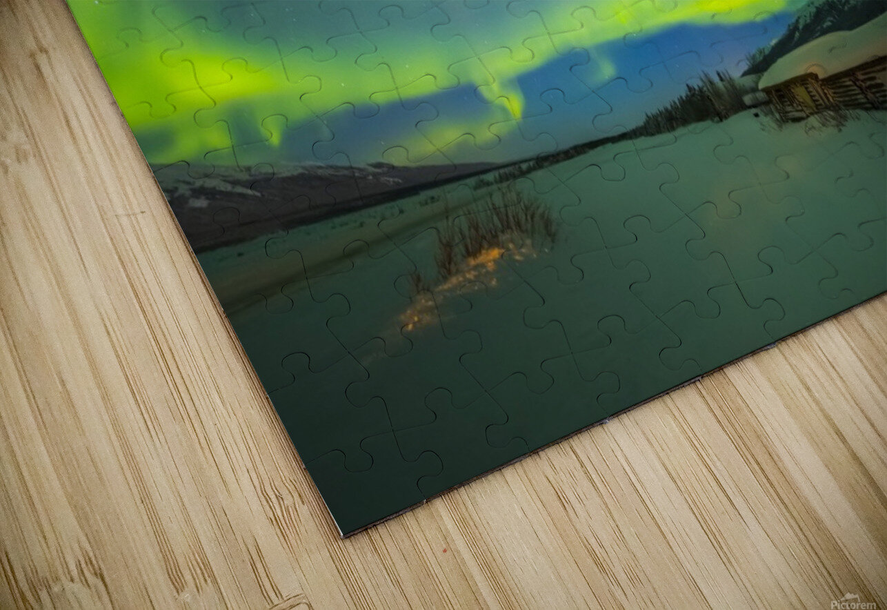 The aurora fills the sky above the historic Black Rapids Roadhouse along the Richardson Highway on a bitterly cold night; Alaska, United States of America HD Sublimation Metal print