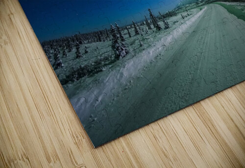 The moon and aurora shine in the night sky over a snow covered Richardson Highway south of Delta Junction; Alaska, United States of America jigsaw puzzle