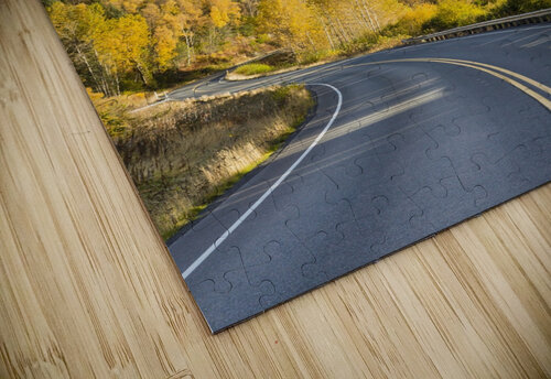 Snow-capped Kenai Mountains dwarf the Seward highway, trees covered in yellow leaves in autumn line the road, South-central Alaska; Seward, Alaska, United States of America jigsaw puzzle