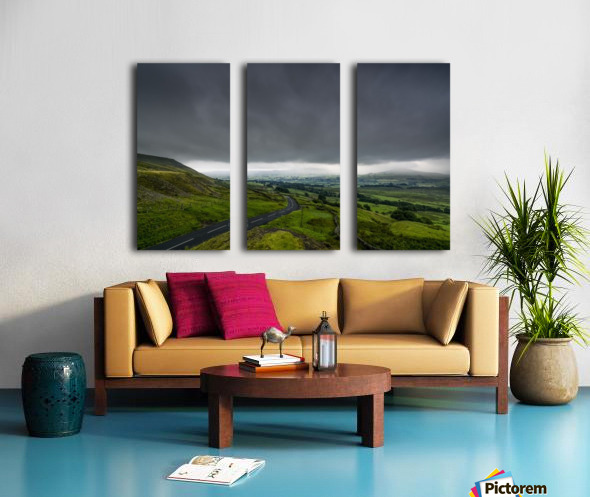 Dark storm clouds over a lush, green landscape and road; North Yorkshire, England Split Canvas print