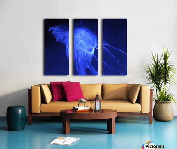 Glowing blue jellyfish in the dark water Split Canvas print