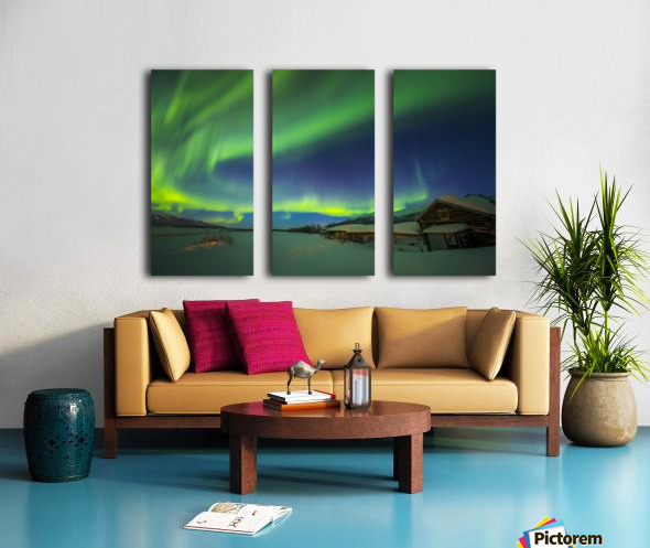 The aurora fills the sky above the historic Black Rapids Roadhouse along the Richardson Highway on a bitterly cold night; Alaska, United States of America Split Canvas print