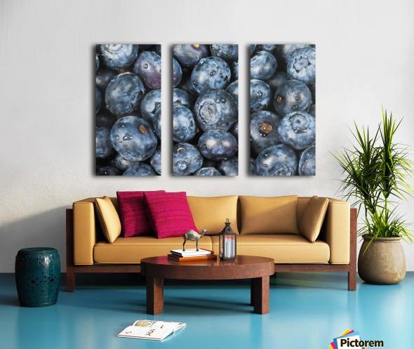 Close up shot of several fresh blueberries. Split Canvas print