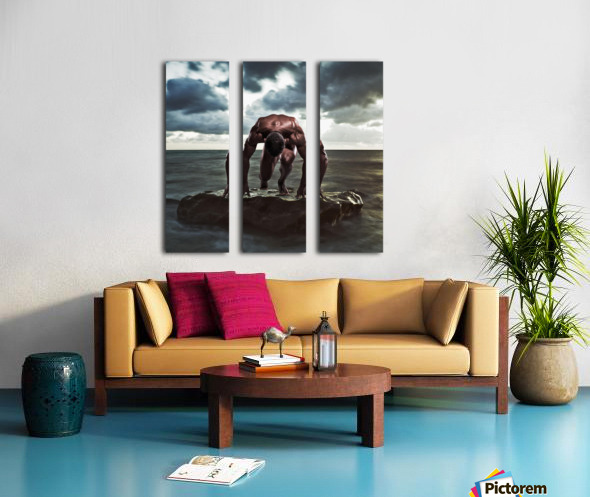 A muscular man in the starting position on a wet rock in the water;Tarifa cadiz andalusia spain Split Canvas print