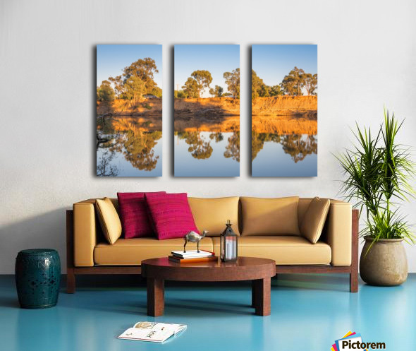 Tranquil river bank reflections at sunrise Split Canvas print