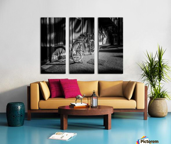 Bicycle parked against the building black and white Split Canvas print