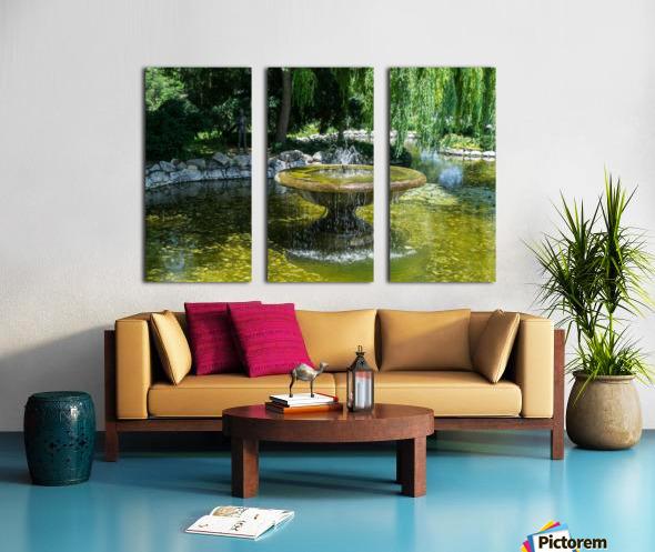 Refreshing Summer - the Little Fisherman Fountain Cheerfully Splashing in the Sunshine Split Canvas print
